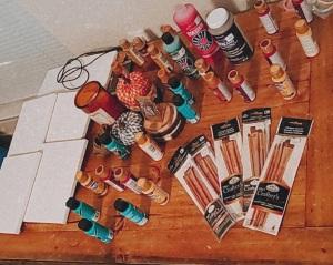 paint party essentials: paint brushes, canvas, multiple paint colors.